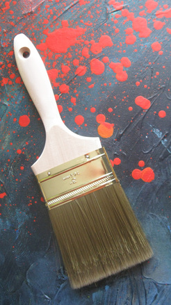 Paintbrush on Spattered Photos