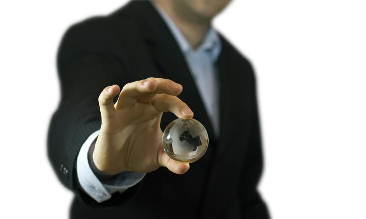 Businessman holding crystal globe