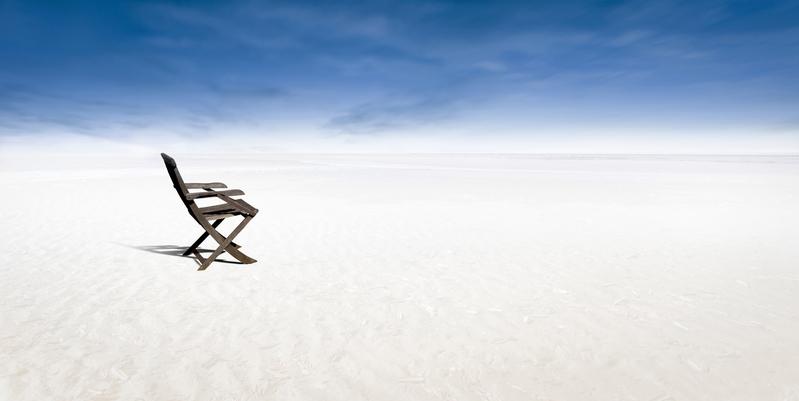 Chair on empty beach