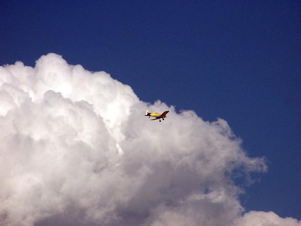 The aeroplane flies high
