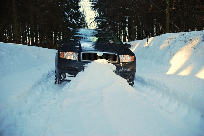 Car trapped in the snow on a winter road