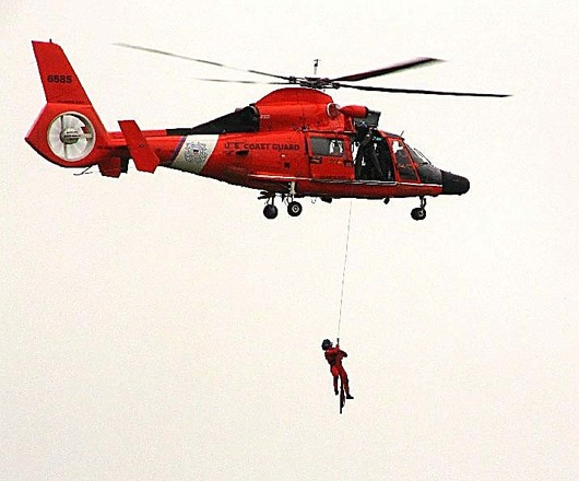 man lowered from helicopter