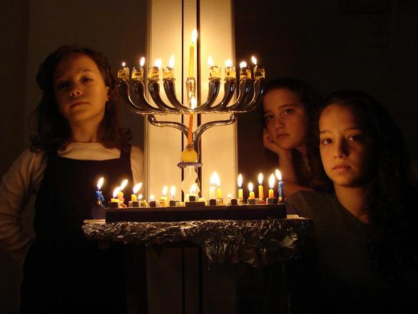 Kids behind Chanukah Menorah updated 1