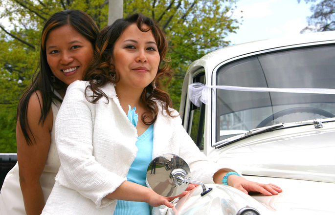 Sister and Girlfriend leaning against a vintage car