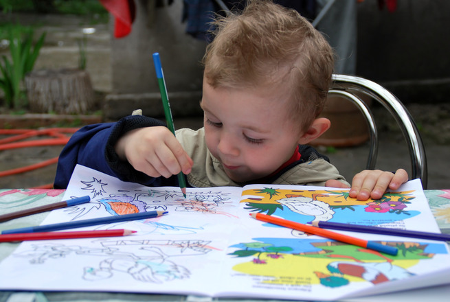 Free Child Colouring A Book Stock Photo