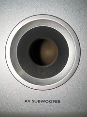 free air subwoofer or enclosed subwoofer