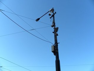 Street lamp with cables and dark blue sky