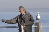 Man with bird food
