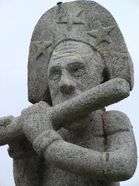 Flute player stone statue
