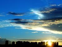 Sky, sun, clouds and city 5
