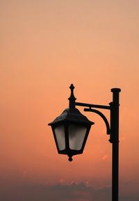 Vintage streetlamp at sunset