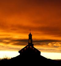 Sunset over church