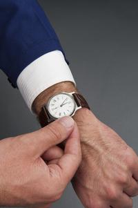 worker adjusts watch