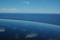 blue sky, ocean & a car