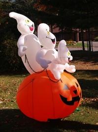 3 ghosts on a pumpkin