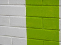 Brick wall with painted stripes