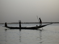 Niger River men in a boat