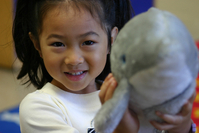 preschool girl with dolphin