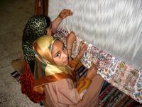 Girls Weaving Rugs in Egypt