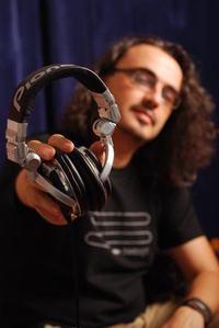a DJ with earphones