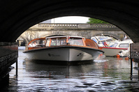 boat through short canal bridge