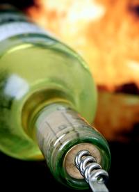 Romantic wine bottle by fire