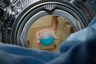 Putting detergent in washing machine