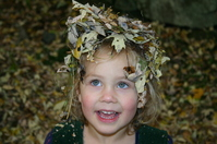 Little Girl In Leaves
