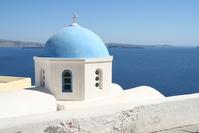 An iconic blue dome church in Santorini (Greece)