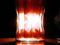 Glass behind a light