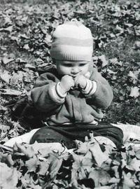baby in leaves 1
