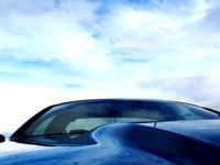 Sports Car Under A Blue Sky