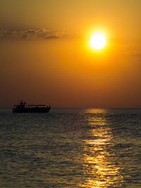 ship on sunset