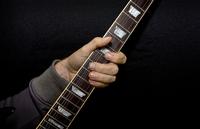 Guitar player bending strings