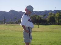 Boy hitting golf balls 1