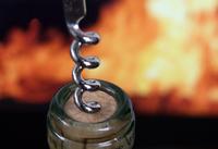Wine bottle by the fire