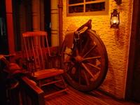 A saddle, a wooden wheel, a la