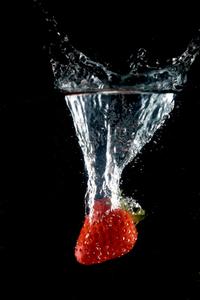 Strawbery splash over black photo file 2