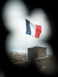 France flag through castle (An