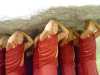 Monks holding rock