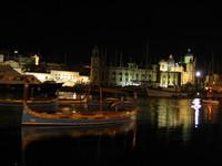 traditional maltese boat at night