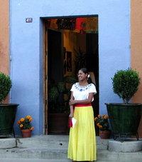 yellow girl, blue door