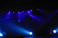 Empty stage with blue spotligh