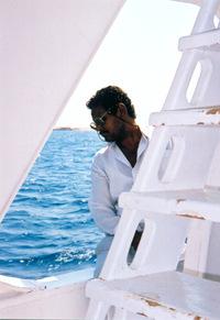 black captain of white boat