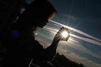 grasping the sun