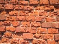 erosed brick wall