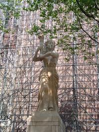 statue between building platfo