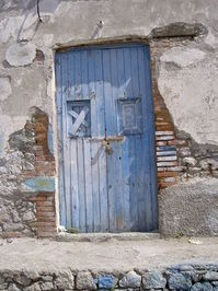 Old door in on a beach