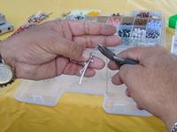 a guy making rosarys