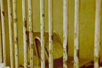 chair behind bars